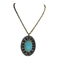 Unusual Robin Egg Blue Celluloid Rose Pendant on Leather Background