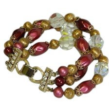 Magnificent Triple Strand Wine Beads and Crystals Bracelet