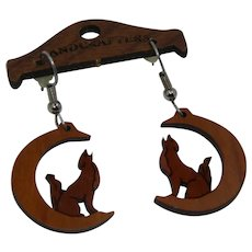 Handcrafter's Carved Wood Wolf Howling at the Moon Earrings on Hand Carved Hanger