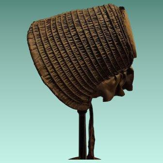 1840's silk poke bonnet. Brown silk.
