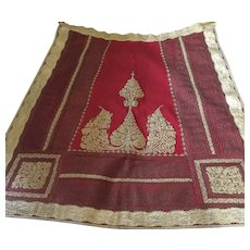 19 th century Macedonian felt apron with gold thread embroidery and braid.