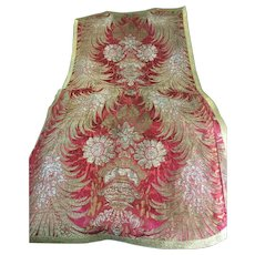Early 19 th century Chasuble front in red and metallic thread woven detail.