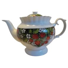 Cream Teapot In Summer Fruits Of Raspberry In Bloom
