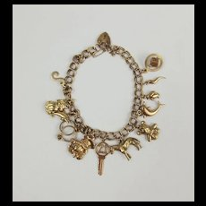9ct Yellow Gold Charm Bracelet With 12 Charms