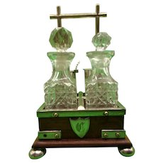Silver Plated And Oak Cruet Set In The Manner Of Christopher Dresser