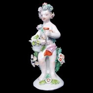 An English Bow Porcelain Figure Of A Putti Holding Basket With Flowers, c.1760