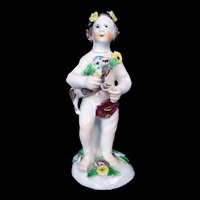 An English Bow Porcelain Figure Of A Putti Holding A Dog, c.1760