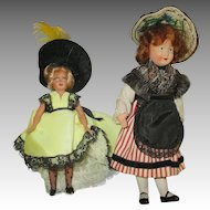 Two Vintage Celluloid Dolls in Original Outfits
