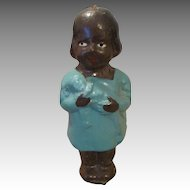 German Black Celluloid Doll holding a Doll