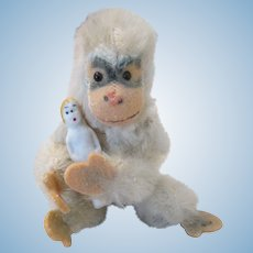 Antique Stone Bisque Doll Being Held By Vintage Steiff Monkey
