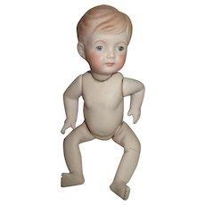 Cute Artist Baby Boy in Need of Dressing