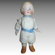 All Bisque Doll with Molded Clothes