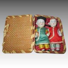 Two All Bisque Oriental Baby Dolls in Original Case