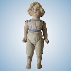 Antique All Bisque Doll with Molded Clothes