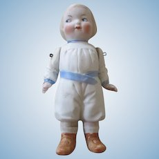 Cute All Bisque Doll with Molded Clothing