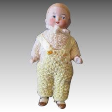 Tiny All Bisque Doll in a Crocheted Outfit