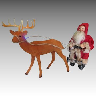 Santa Doll on Sled with Reindeer