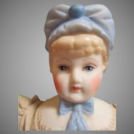 Beautiful Artist Bonnet Head Doll
