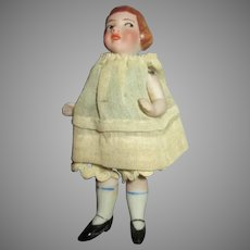 Unusual Antique All Bisque Miniature Doll with Side Glancing Eyes and Molded Hair
