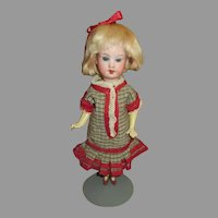 "Adorable 8"" Bisque Head Doll in Antique Dress"