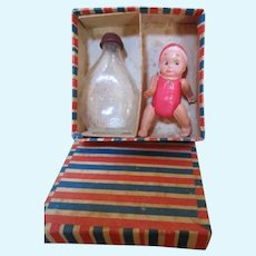Vintage Celluloid Baby Doll in Box with Glass Bottle