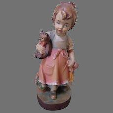 Adorable Dolfi Figurine with Doll and Teddy Bear