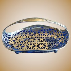 Ornate Sterling silver footed Basket with Handle by Gorham date Mark 1907