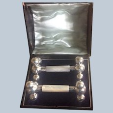 Boxed pair English sterling silver and Mother of Pearl Knife Rests