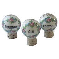 Three Porcelain Hand Painted Bottle Stoppers -Bourbon, Gin, Scotch