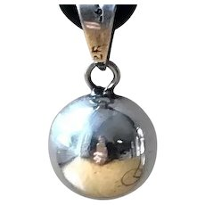Sterling Silver Ringing Ball Pendant
