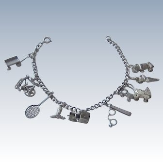 Ten sterling Silver Charms on Sterling Bracelet