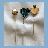 Three stick pins