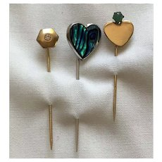 Three stick pins