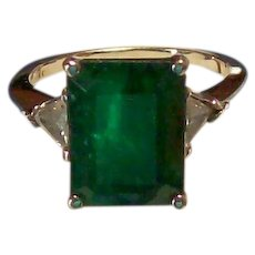 Emerald and Trillion Cut Diamond Ring in White Gold