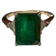 Emerald and Trillion Cut Diamond Ring in White Gold
