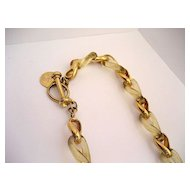 An ESTATE Clear, lightly Golden Razin Vermeiled Silver Necklace with Taggle clasp