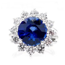 An exquisite 5.92ctw Ceylon GIA Natural Royal Blue Sapphire and Diamond Platinum Cluster Ring