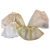 Four Vintage Doll Slips