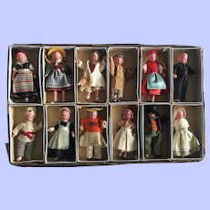 Mint in Box Group of Twelve Boxed Celluloid Doll House Dolls 1940