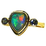 Ladies Lightning Ridge 1.04 Carat Solid Opal Ring set in 18K Yellow Gold Accented by Sapphires