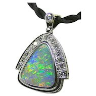 Ladies 15.10 Carat Solid Opal 18K White Gold Pendant adorned with Diamonds