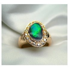 Ladies Solid 1.61 Carat Australian Opal Ring set in 18K Yellow Gold with Diamonds