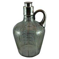Silver overlay glass decanter