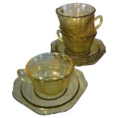 "Four ""Madrid"" Amber Glass Cup and Saucer Sets"