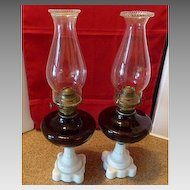 Pair of Amethyst Glass Oil Lamps with Milk Glass Bases