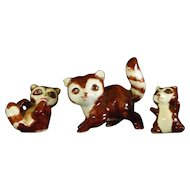 Family of Ceramic Raccoon Figurines
