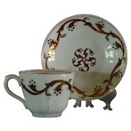 "Ironstone ""Pinwheel"" Decorated Cup and Saucer"