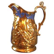 Copper Lustre glazed pitcher