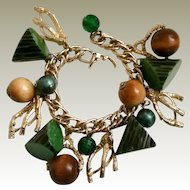 Bakelite Charm Bracelet 1950s Vintage Green with Black Resin Wash Log or Antler Type Wedges Wood Faux Pearls Faceted Plastic Beads