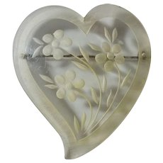 Clear Lucite Reversed Carved Heart Pin